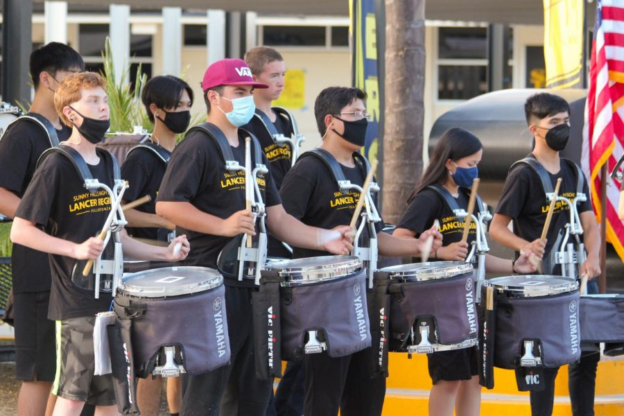 The Sunny Hills drumline performs before the start of principal Allen Whitten's introduction for Back to School Night Tuesday Aug. 31.