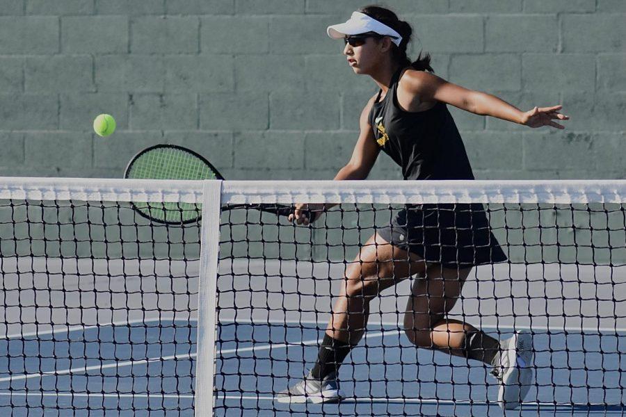 Freshman Daniela Borruel hits a forehand volley at a Sept. 10 pre-season game against El Dorado at the Sunny Hills courts.