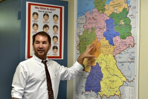 Sergey Artemyev stands in front of a European map to indicate where the German state Hessen is located. Artemyev, who taught at La Habra High School before coming here this school year, looks forward to teaching his students about German culture and promoting the language at Sunny Hills.