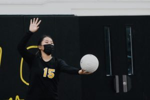 Setter junior Jacky Woo gets ready to serve the ball against Buena Park High School's girls volleyball team in an Oct. 5 home game that the Lady Lancers won in straight sets.