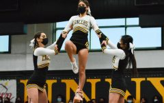 Sunny Hills cheerleaders form a pyramid during their Pep Squad routine.