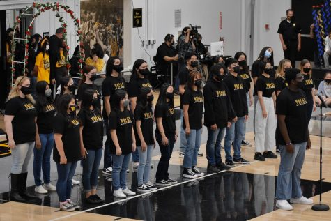 """The Sunny Hills High School vocal ensemble performs a medley from """"Beauty and the Beast"""" in the gym on Oct. 15 during the annual Homecoming assembly."""