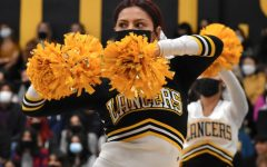 Senior Blanca Aguilera waves her pom poms in a Pep Squad performance.