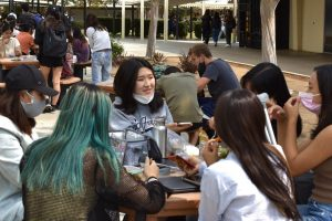 Sophomore Irene Sheen eats lunch with her group of fellow 10th grade friends near the math and science wing. Unlike last year's virtual learning when she typically spent her lunch time in solitude, Sheen appreciates the company of her friends.