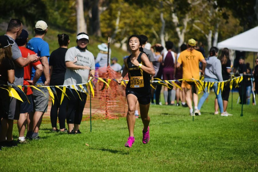 Sophomore Esther Kim sprints to the finish line during the Sunny Hills Wayne Walker Invitational Sept. 25 at Fullerton's Craig Park. Kim placed fifth in the girls sophomore division.