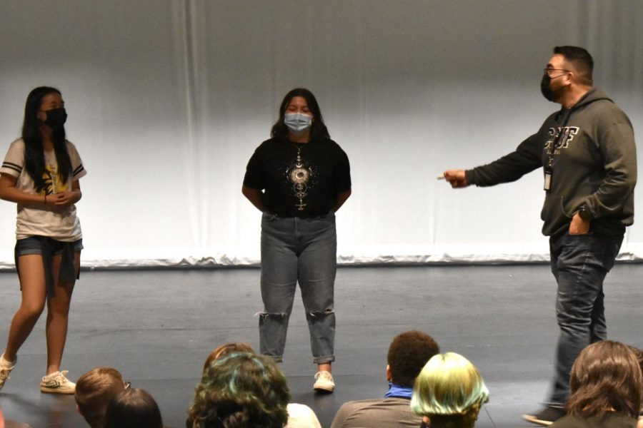 New teacher Christian Penuelas (right) calls up his fifth period theater students, sophomore Isabella Castaneda (middle) and freshman Anabelle Kim (left) for a demonstration of an improvisation performance. All drama levels are in one class period.